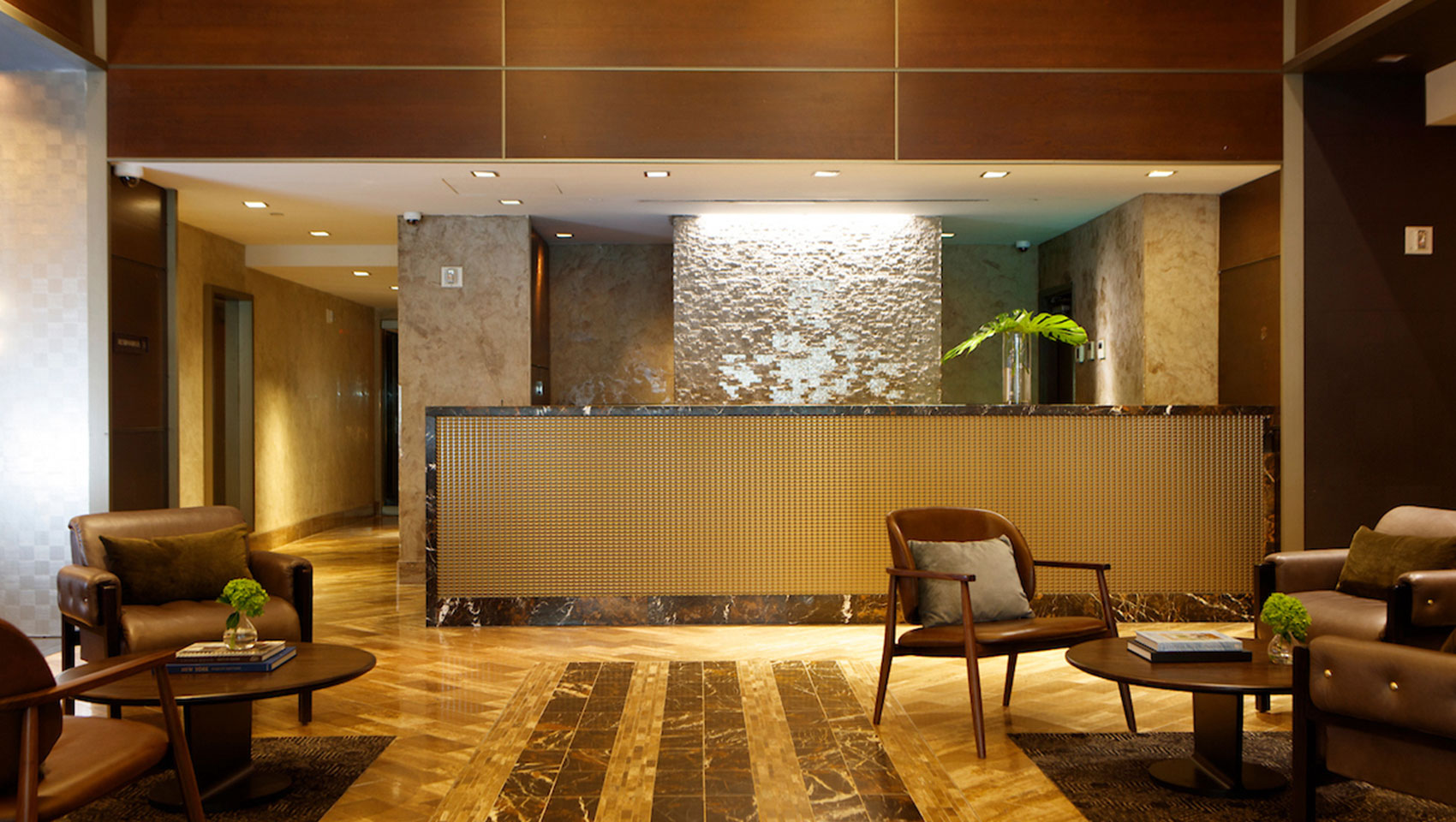 Kimpton Muse Hotel lobby with front desk and adjacent seating areas
